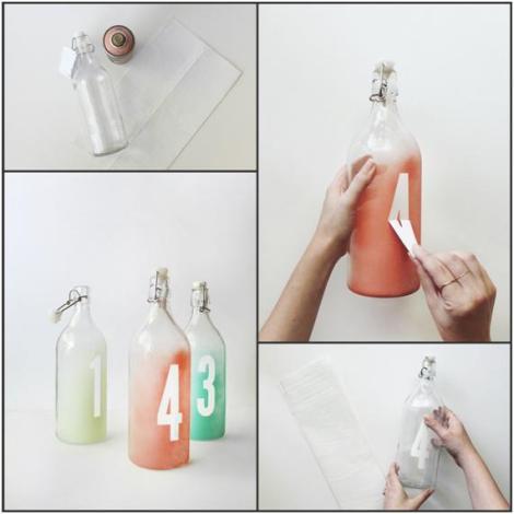 http://lovechocolateandweddings.com/2014/06/02/tutorial-numeremos-las-mesas-con-botellas/